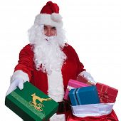 santa claus is giving you presents from his big bag on white background