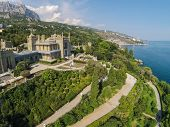 YALTA - AUG 27: Beautiful Vorontsov Palace against the sea, sky and mountain Ay Petri on August 27, 2013 in Yalta, Ukraine. View from unmanned quadrocopter.