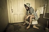 Girl Sitting On The Toilet