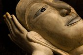 image of recliner  - Face of Buddha statue reclining on hand at Sai Thai Temple in Krabi province in southern Thailand - JPG