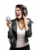 Half-length portrait of rock singer with earphones wearing leather jacket and keeping static mic, is