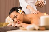 Relaxed Woman Receiving A Back Massage At Health Spa