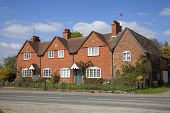 foto of english cottage garden  - Row of brick cottages - JPG