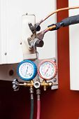pic of air pressure gauge  - Gauge Hang on the White Air Condition - JPG