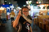 Snake show at the night market in Hua Hin