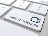 Video Advertising on White Keyboard Button.
