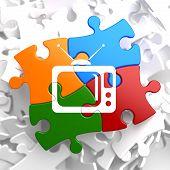 TV Set Icon on Multicolor Puzzle.