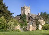 stock photo of english cottage garden  - Pretty village church and cottage at Cutsdean - JPG