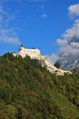 Majestic medieval Burg Hohenwerfen. The castle is situated on top of the mountain and surrounded by dense forest