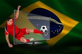 Composite image of fit football player kicking ball through tv against brazilian flag waving