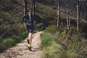 mountain trail marathon running man training for fitness and healthy lifestyle