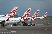 SYDNEY - APRIL 3: Aircrafts of the Virgin Australia fleet at Sydney Domestic Airport April 3th, 2014