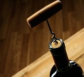 Opening wine bottle with a corkscrew