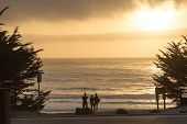 Family watching the sunset in Carmel, California