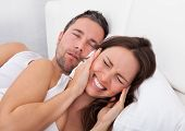 Woman Disturbed With Man Snoring
