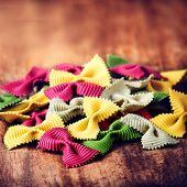 Fresh Italian Colourful Pasta On Old Wooden Background Close Up.  Raw Bow Tie  Pasta Macro. Italian