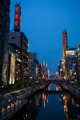 OSAKA, JAPAN - MAY 28, 2008: Artificially dug Dotonbori canal located in the Dotonbori area. This ar