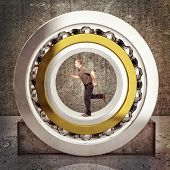 man run inside of huge ball bearing