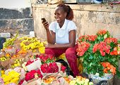 NAIROBI, KENYA-FEBRUARY 5, 2014:  Unidentified black woman sells flowers at old market in centre of Nairobi on February 9, 2014.  Africa.