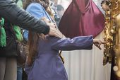 Girl Tries To Touch The Skirt Of The Throne To Have Good Luck, Popular Tradition In Andalusia, Easte