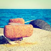 pic of bollard  - Rusty Bollard on a Concrete Pier Photo Filter - JPG