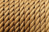 stock photo of coiled  - rope coiled on a Large suction strainer on a old fire engine - JPG
