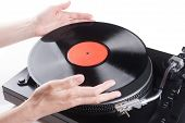 Hands Placing Lp On Turntable
