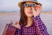 Woman Looks Through Binoculars