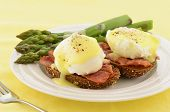 image of benediction  - Eggs Benedict with hollandaise sauce on hearty multigrain toast with Canadian bacon and asparagus - JPG