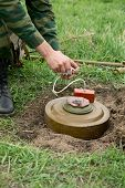 stock photo of landmines  - Minesweeper is preparing for a mine detonator - JPG