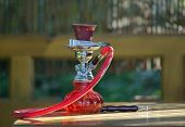 foto of hookah  - Eastern hookah on the table in the garden.