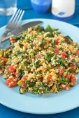 Bulgur and vegetable pilaf with spinach on a plate