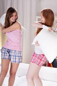 Girls Fighting With Pillows