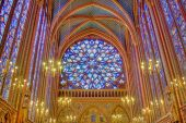 picture of stained glass  - view of stained glass windows and rosacea with chandelier - JPG