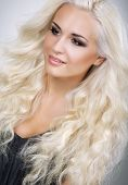 Classy Glamorous Blonde With Waved And Frizzy Hair