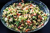 tabbouleh made of couscous and various vegetables