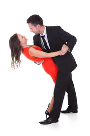 pic of waltzing  - Portrait Of A Happy Couple Dancing On White Background - JPG