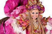 Portrait of young woman in pink carnival costume, close up against white background