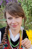 Young woman in traditional Polish costume, a Polish folk costume.