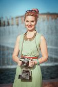 Beautiful Girln In Vintage Clothing With Retro Camera