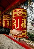 Hand Twists Prayer Drums At The Buddhist Temple In St. Petersburg