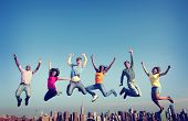 stock photo of friendship  - Cheerful People Jumping Friendship Happiness City Concept - JPG