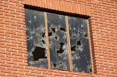 Close up of a Broken Window on an old Brick Building