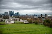 Overview of Greenwich Looking Toward Canary Wharf with Cloudy Sky, London, England