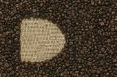 Cafe edition coffee beans on Jute background