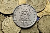 Coins of Greece. Atom, electron and neutron depicted in the old Greek 10 drachma coin.