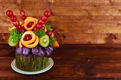 Table decoration made of fruits on wooden table on wooden wall background
