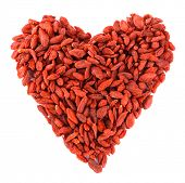 Heart shaped goji berries isolated on white