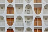 Building Facade With Many Doors And Oblong Pattern Wa