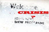 Weathered Advertising Sign And New Text Crisis